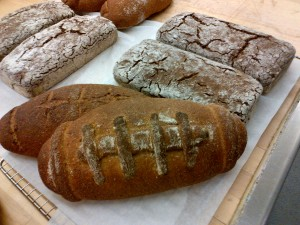 Anise bread (white crackly top) and whole grain football bread Photo by Kimberley (c)2015